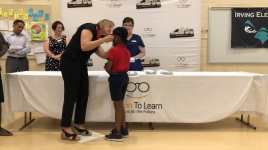 Stacy Van Gorp helps Irving student try on her new specs