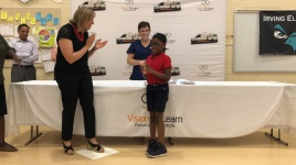 Stacy Van Gorp cheers on Irving student w/ her new glasses!